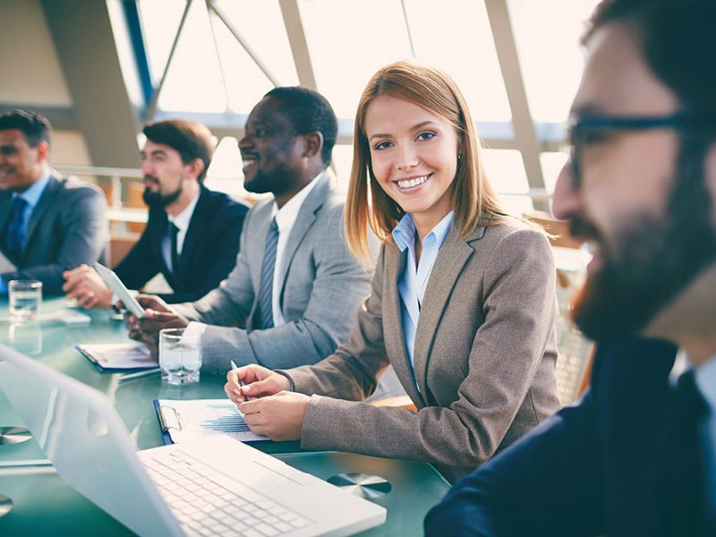 women smiling in business meeting