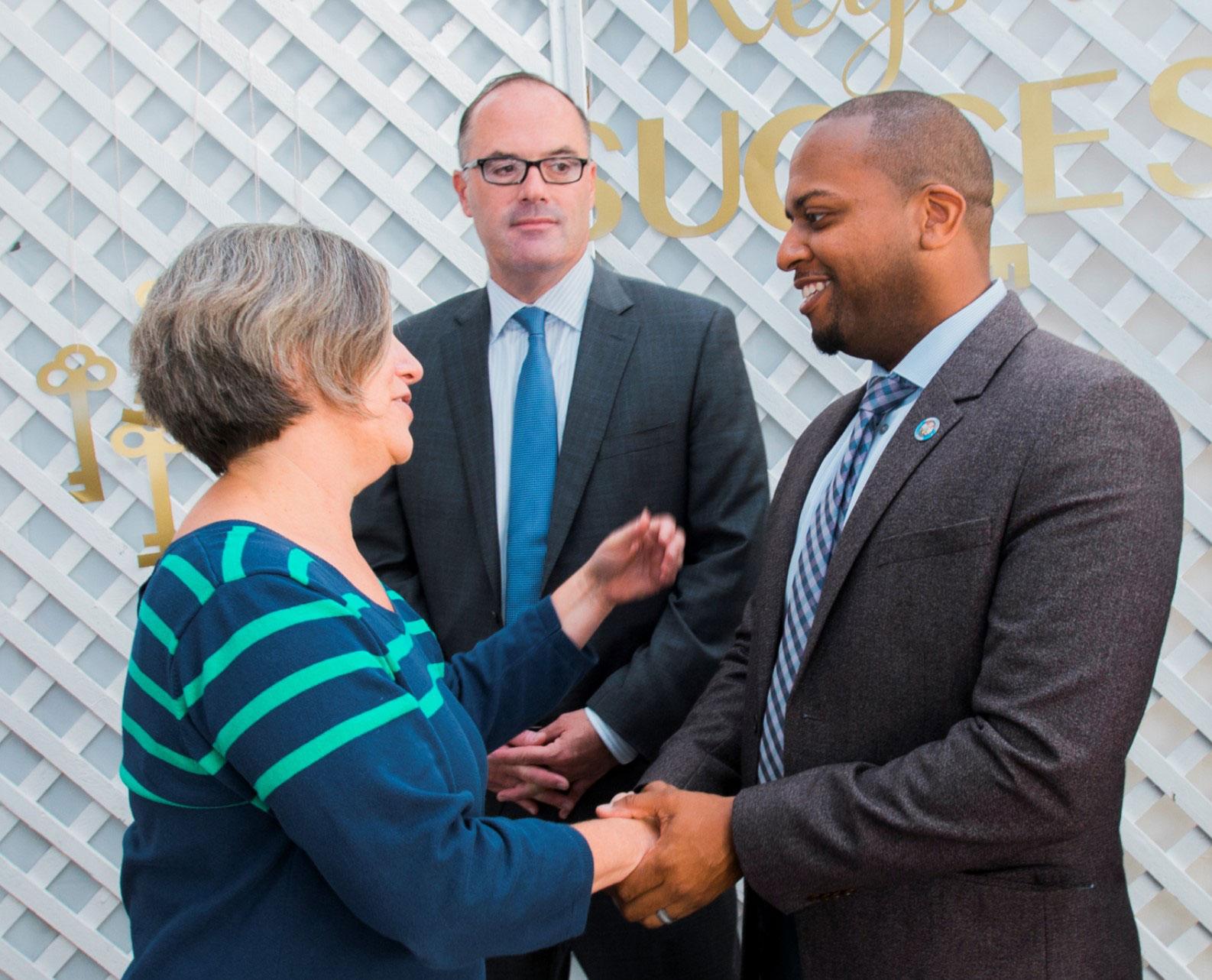 Administrative Internship program members shaking hands