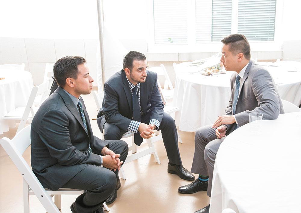 three admin interns talking