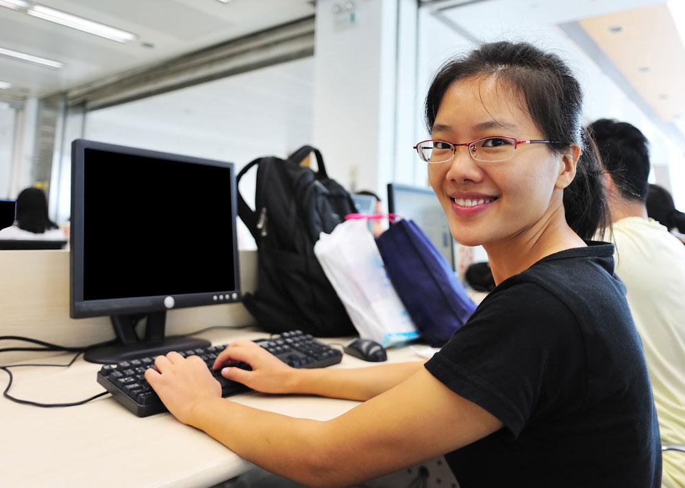 young women on desktop computer