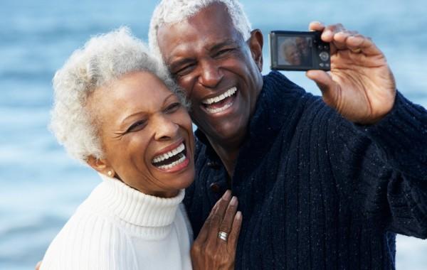 two senior citizens taking a selfie